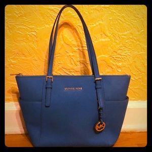Medium sized blue Michael Kors bag